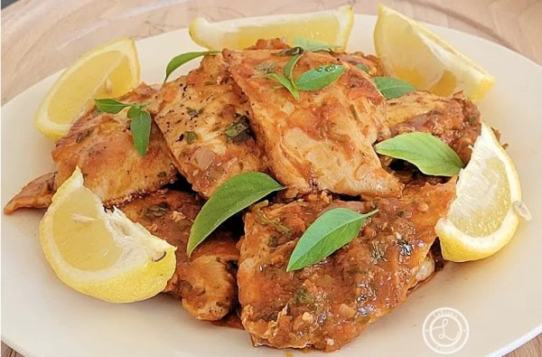 Fusion Moroccan Chicken on a plate with lemon slices
