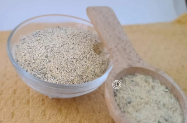 Seasoning in a bowl and on a wooden spoon