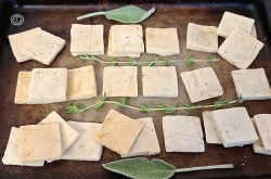 Crackers with sage & thyme on a baking stone.