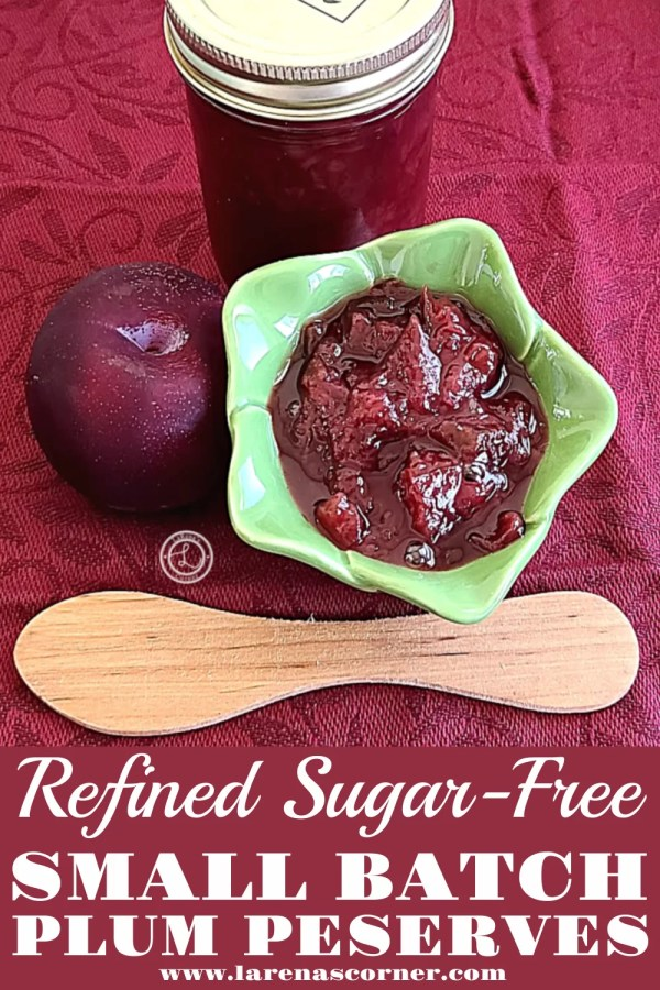 Small Batch Plum Preserves in a bowl and in a jar with a plum and wooden knife