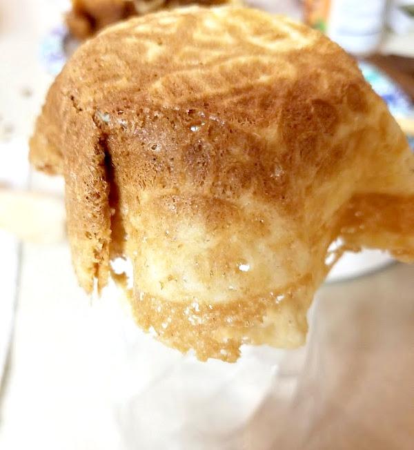Wrap warm cookie around bottom of glass
