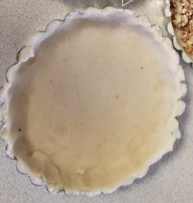 Chopped pecan in bottom of tart shells