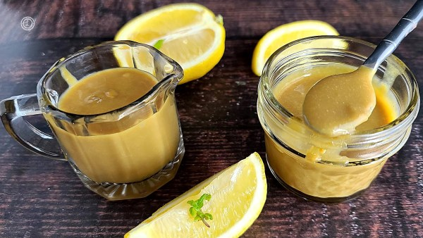 Lemon Curd Syrup with sliced lemons