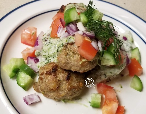 Baked Meatballs with cucumber sauce, diced cucumbers, tomatoes and red onions