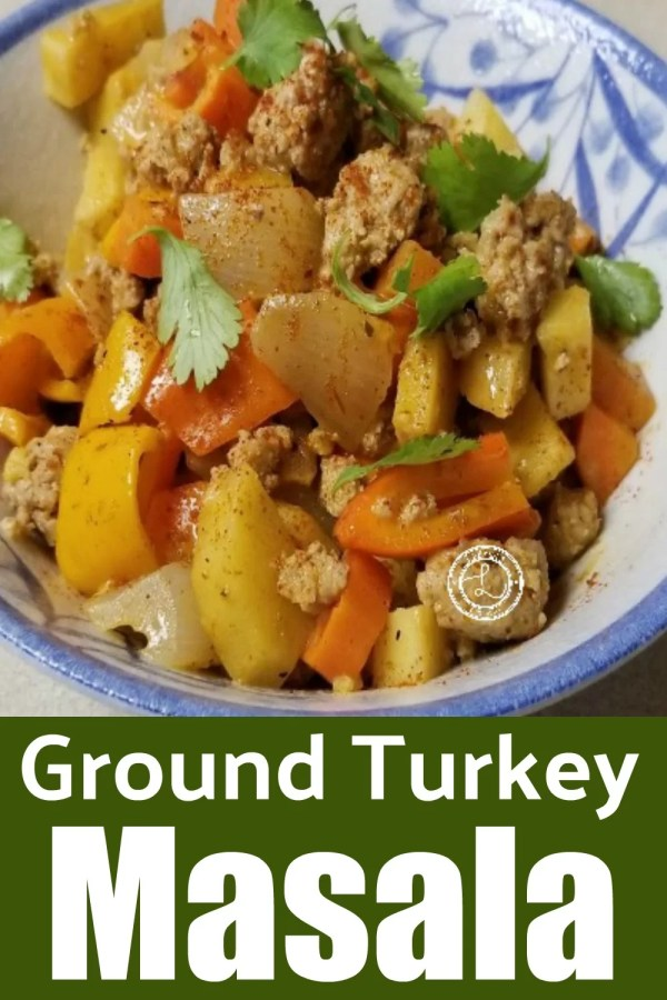 Ground Turkey Masala in a bowl with bell ppers, onions and parsley to decorate