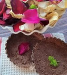 A picture of two tart shells with rose petals.