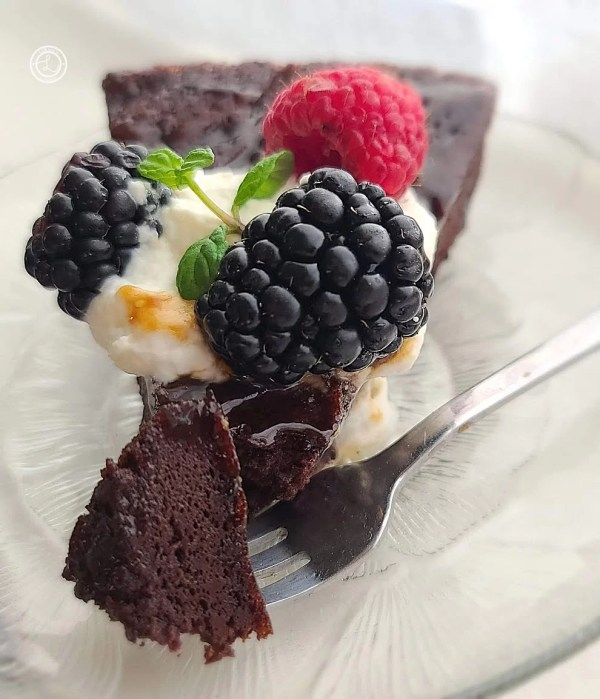A slice of cake with a bite on a fork.