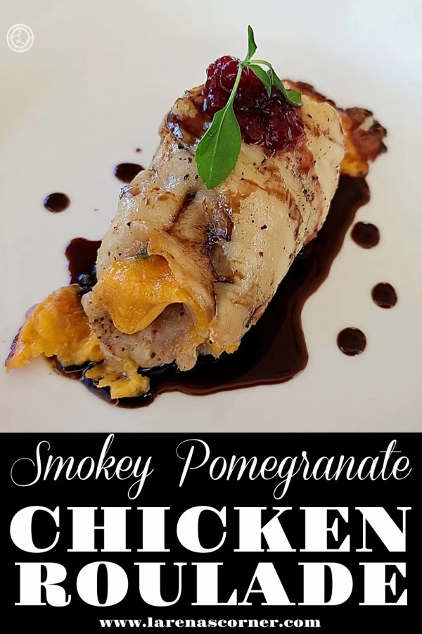 Chicken Roulade on a plate with pomegranate glaze around it.