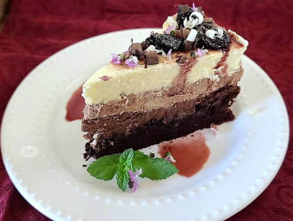 Triple Mousse Chocolate Cake on a plate and decorated