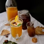 A Picture of the ingredients and drink. With some leaves and star anise to decorate