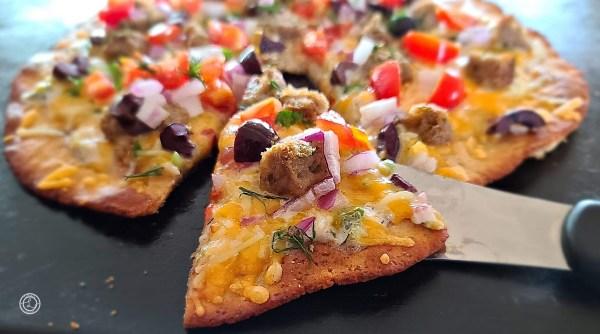 Gluten-Free Greek Meatball Pizza slice ready to eat
