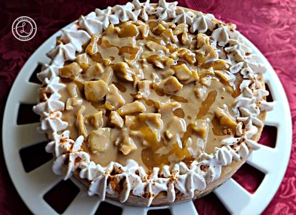 Cinnamon Apple Caramel Cheesecake Recipe topped with cinnamon whipped cream, leftover cinnamon caramel apple sauce and caramel sauce.