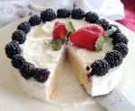 A vanilla cake with Vanilla Ermine Frosting on a whole 6 inch cake with fruit decoration