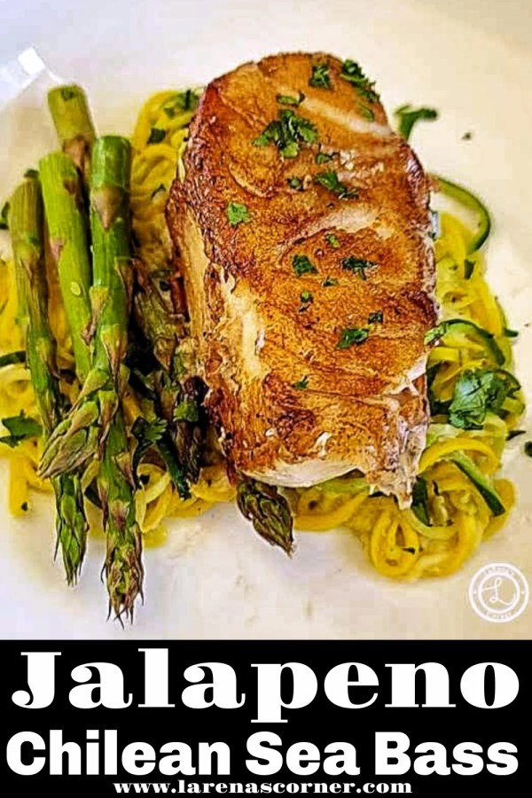 A piece of Jalapeno Chilean Sea Bass with zoodles and asparagus with parsley