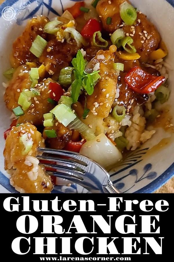 Gluten-Free Orange Chicken in a bowl with a bite on a fork