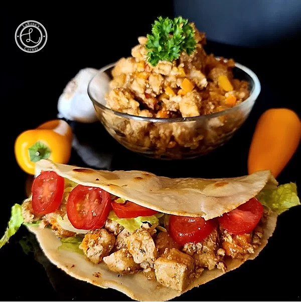 A picture of a bowl of Gluten-Free Chicken tacos and a taco. So delicious.
