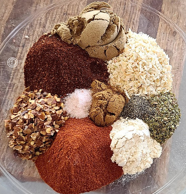 A picture of all the separate spices in a bowl. Homemade Taco Seasoning Recipe