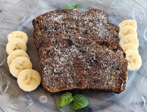 Banana French Toast on a plate with some mint and banana slices
