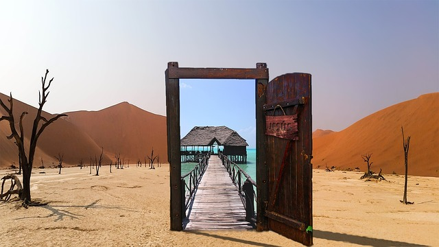 Image of desert with open door leading to a dock on a large body of water