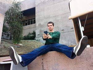 "Daniel Pestolesi, 20-years old, broadcast journalism major, taking a ""selfie."""