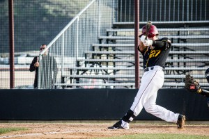 Photo by: Matt Corkill Brandon Cody, sophomore, hits a solo HR in the bottom of the ninth.