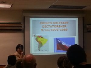 Ana Maria Cobos, Circulation Librarian at Saddleback presenting on Chilean exiles and their music, may 1st 2014. Photo by Danny Pestolesi
