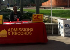 Doris Muchirahondo provides information from Admissions and Records during Saddleback College's Welcome Week event at the Quad, on January 23, 2014. (Marivel Guzman)