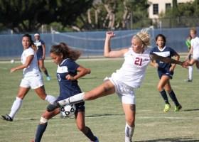 Saddleback player No.21 freshman, Julianna Caldwell battles back trailing 1-0 IVC player Bernice Pacheco (Photographs/Dominic D. Ebel)