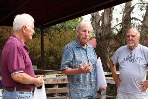 Larry Oien, 86, left and Bill Passavanti, 80, right, listens to Aaron Rosen, 86, center, explain when the hillside sculpture studio was closed. All three sculpture students found the outdoor sculpture studio closed down on the first day. (Photograph/Anibal Santos)