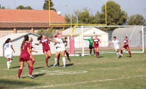 Saddleback College's women's soccer team gather to block goal shot attempt. (Photographer/Anibal Santos)