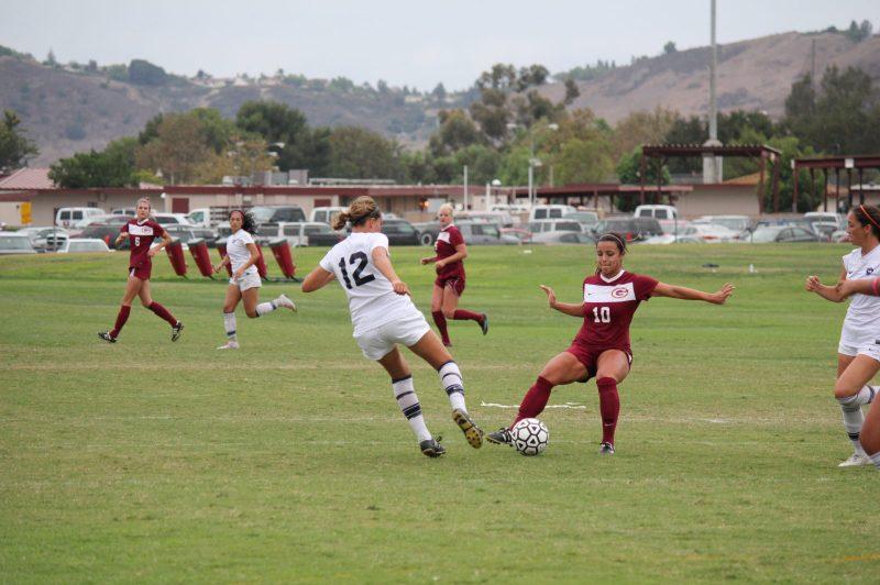 Saddleback College women's soccer team sophomore, midfielder, captain, Krista Flores kicks at midfield to corner post (Photographs/Dominic D. Ebel)