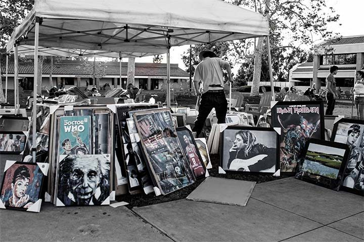 Saddleback College held a photography art sale last Monday and included famous photos, band posters, famous paintings, and more. The art sale will continue into Tuesday (photograph/Hannah Tavares).