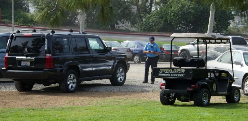 Campus officer is seen enforcing regulation 411.