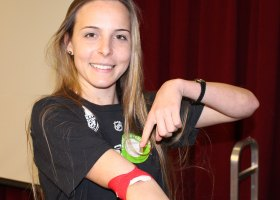 Hana Anderson, 19, nursing, proudly shows her dressing after donating blood for the American Red Cross blood drive at Saddleback College. (Capper Durham)