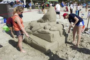A family participating in the sand sculpting competition, weekend one, of the festival. (Photo by Niko LaBarbera)