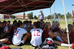 Head Coach B J McNichol prepares the team during a group meeting. (Dominic Ebel/Lariat)