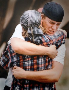 Two students at Columbine hug in the midst of the siege. Two shooters murdered 12 of their classmates before committing suicide. (George Kochaniec Jr.)