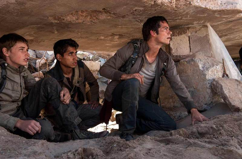 Handle the Burn: Dylan O'Brien, right, Alexander Flores, and Jacob Lolfland hide from the enemy WCKD (Fox Pictures).