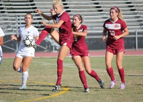 Saddleback's sophomore forward Amber Martin, (No.8, red) breaks toward Cypress to surge the midfield. (Dominic Ebel/Lariat)