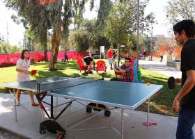 Students enjoying a game of ping pong in the Saddleback quad.