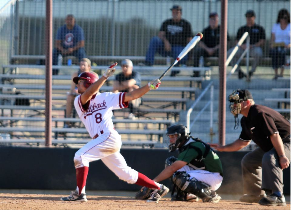 Saddleback sophomore Kyle Candalla (No. 8) swings and watches his hit. The Gauchos are currently tied for second place in the Orange Empire Conference with their upcoming opponent, Cypress College. (Nick Nenad/Lariat)