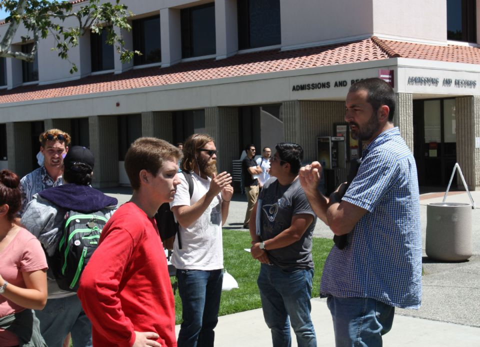 Students and faculty members argue about their views on abortion. The Center for Bio-Ethical Reform displayed numerous photos of dismemberment and genocide at Saddleback College on Tuesday and Wednesday. (Nick Nenad/Lariat)