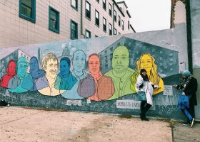 Members of ASG standing in front of street art in D.C. (Courtesy of ASG)