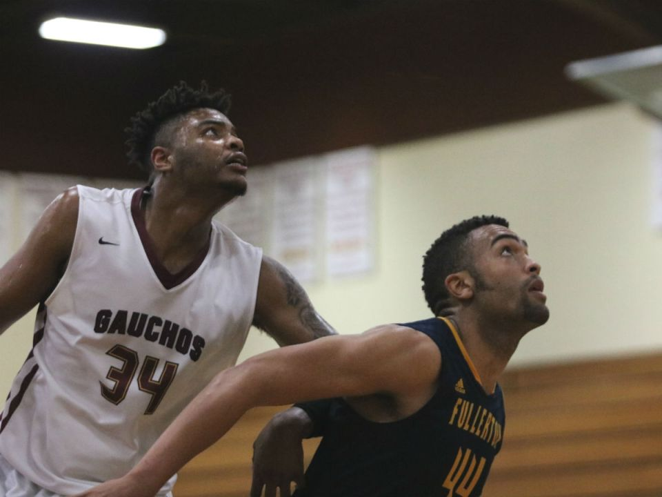 Braeon Brady battles in the post with a Fullerton College opponent in last Tuesday's conference showdown. (Courtesy of Colin Reef)