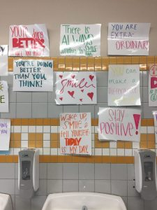 Signs that were hung above the sinks instead of mirrors. Photo courtesy Sabrina Astle.
