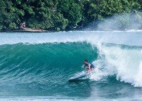 Surf's up: Kevin Skvarna confidently grips the fiberglass rail of his longboard, shredding the inside set wave. (Kevin Skvarna/Courtesy)