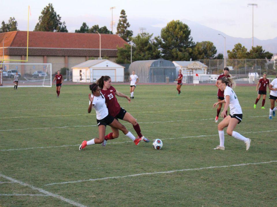 Jessica Kron battles with Golden West player for loose ball. (DJ McAllister/Lariat)