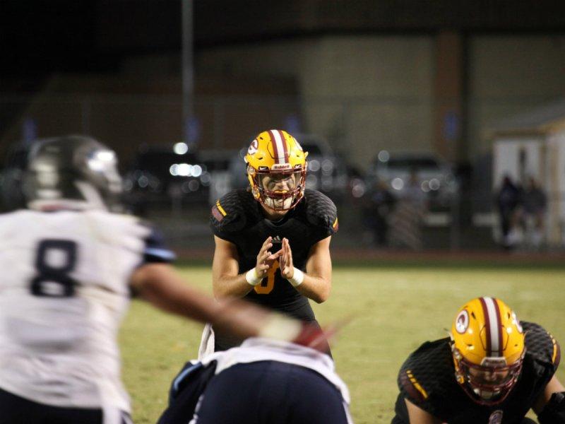 Gauchos Freshman Quarterback #8 Cam Humphrey calls for the snap (Adam Gilles/Lariat)