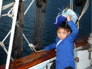 A young pirate in training mans the Californian after a gun battle at the Tall Ships Festival. (Adam Gilles/Lariat)