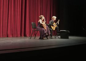 Moller and Fraticelli's passion is clearly displayed as they play the finale to their guitar duo on the McKinney theatre stage. (Maria Marquez / Lariat)